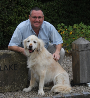 John Farrell with golden retriever
