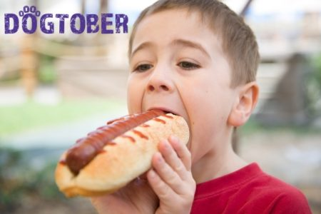 Boy with hot dog Dogtober fundraising