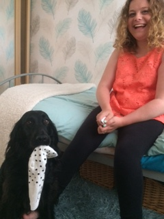 assistance dog passes sock to girl