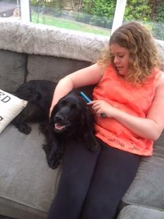 girl cuddles assistance dog