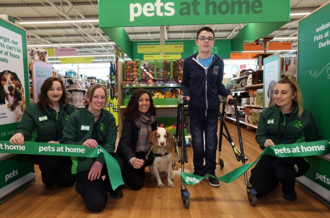 dogs for good client cuts opening ribbon