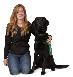 Trainer Leanne sat with Labrador cross golden retriever Harry