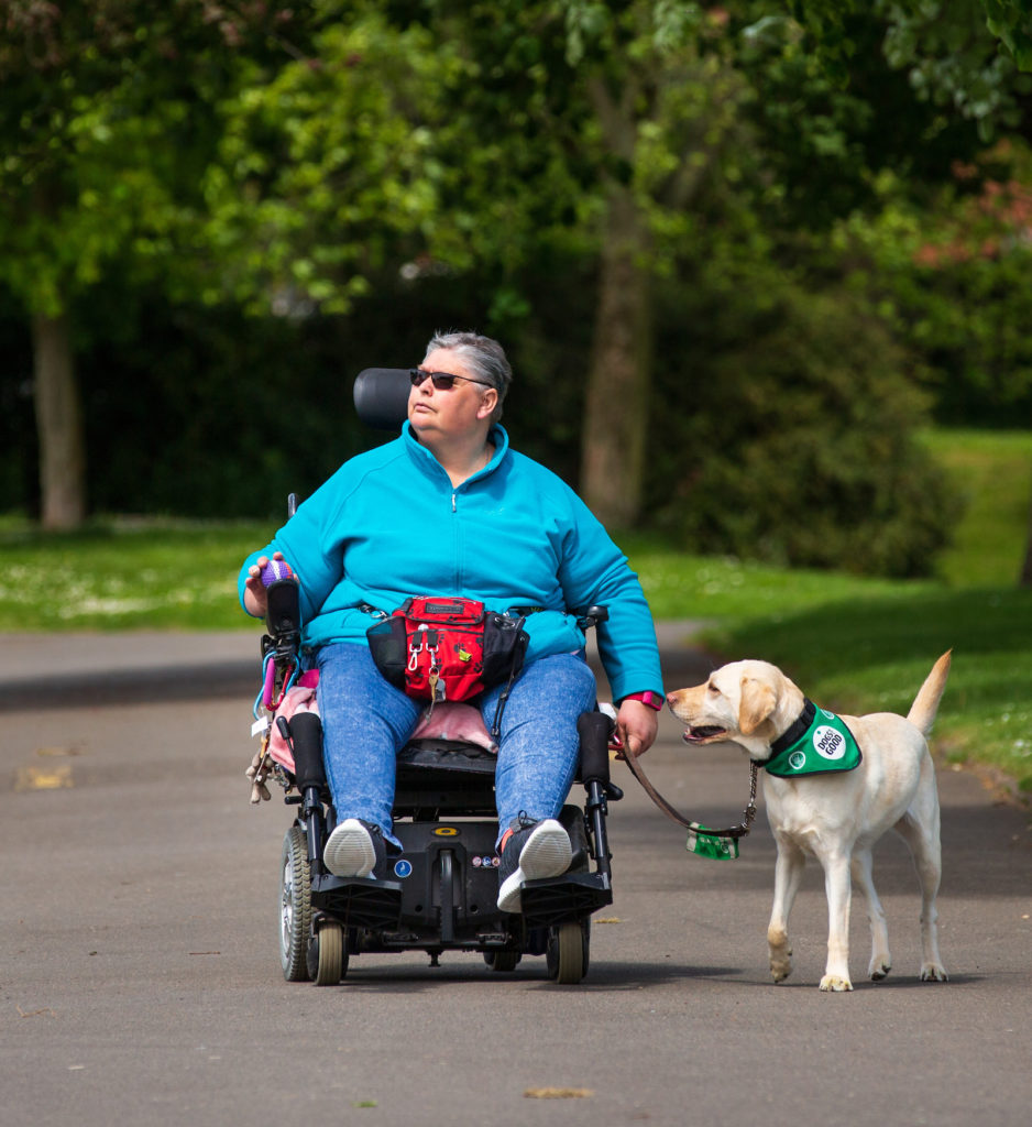 yvonne in wheelchair in park with purdy