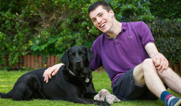 black Labrador assistance dog with Joel