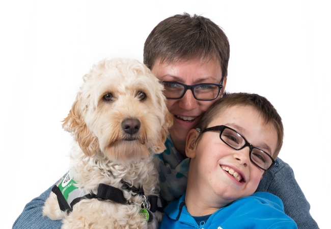 Assistance dog Elmo with Elliot and mum Caroline
